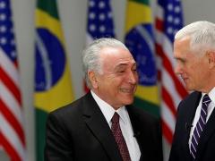Brazilian President Michel Temer (L) greets US VP Mike Pence. Brasilia, Brazi